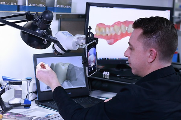 One of the team designing and creating dental restorations for dentists